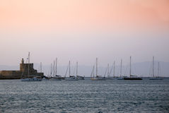 Rhodes harbour - Greece. Rhodes harbour at the sunset -  Greece Stock Photo