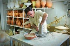 RHODES ISLAND, GREECE, JUN,06, 2013: Jug master forms new clay jug amphora in Greek workshop. Greece islands holidays vacation tou stock images