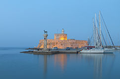 Rhodes island in Greece. Saint Nikolaos fortress and the statue of the Deer at Rhodes island in Greece royalty free stock photos