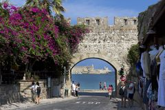 Rhodes Old City - Ancient wall of medieval town, Gate of the Virgin, Dodecanese Islands, Greece. Rhodes island, Greece - September 12, 2018. People walk through stock photo