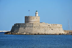 Rhodes Landmark Mandraki Port. Greece . The medieval lighthouse Stock Photos