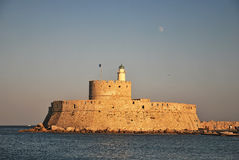 Rhodes Landmark Mandraki Port. Greece . The medieval lighthouse Royalty Free Stock Photos