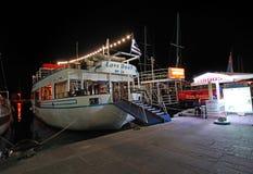 Rhodes Mandraki harbour boat by night, Greece Royalty Free Stock Photos
