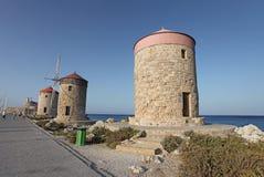 Rhodes Mandraki harbour wind mills. Greece Royalty Free Stock Image