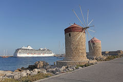 Rhodes Mandraki harbour wind mills. Greece Royalty Free Stock Photo