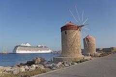 Rhodes Mandraki harbour wind mills. Greece Royalty Free Stock Photo