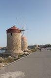Rhodes Mandraki harbour wind mills. Greece Stock Image