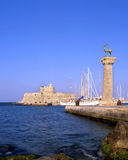 Rhodes old port. Rhodian deer atop the columns that protect Mandraki harbour entrance, on the Greek island of Rhodes stock photography