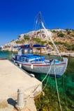Rhodes sea bay with cruise boat Stock Photos