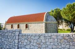 Rhodes small church with stony landmark Royalty Free Stock Photos