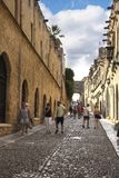 Rhodes town is a walled city. This is the street of the Knights Inns. Rhodes Old Town resembles a medieval time capsule behind a double ring of high walls and a royalty free stock image