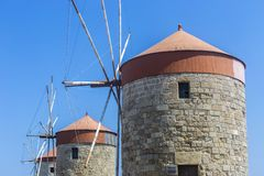 Rhodes windmills - Greece. The Windmills of Mandraki Harbor. Rhodes - Greece royalty free stock image