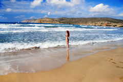Rhodes. The young beautiful woman on seacoast. Stock Photography