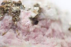 Rhodochrosite MnCO3 with iron pyrite FeS2 Macro Royalty Free Stock Photos