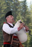 Rhodope bagpiper playing. ROZHEN, BULGARIA, JULY 15, 2016: Rhodope bagpiper playing tunes on a famous rozhen folklore festival in bulgaria Stock Photography