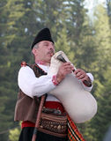 Rhodope bagpiper playing Royalty Free Stock Images
