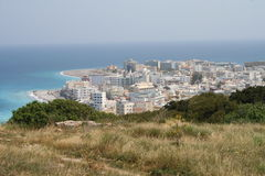 Rhodos, Aegean Greece. Greek island of Rhodos - famous holiday resort. View over the capital of Rhodos and the beach stock image