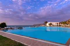Rhodos, Greece - August 2016: Beautiful sunset over a beach resort with infinit pool in the Ixia gulf, on the western coast of the. Rhodos island, near the royalty free stock photo