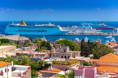 Rhodos, Greece - August 2016: Many luxury cruise ships anchor in the new Mandraki port of Rhodes, near the old town and. The defense wall. Rhodes Island is a royalty free stock images
