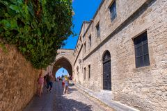 Rhodos, Greece - August 2016: People walking down the street of Knights Ippoton in City of Rhodes, Rhodes Dodecanese. Island, Greece. Famous tourist destination stock photography