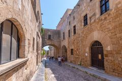Rhodos, Greece - August 2016: People walking down the street of Knights Ippoton in City of Rhodes, Rhodes Dodecanese. Island, Greece. Famous tourist destination royalty free stock images