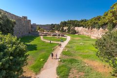 Rhodos, Greece - August 2016: Walls of Rhodes old town and the inner moat in the Palace of the Grand Master of the Knights of. Rhodes Kastello, a medieval stock photo