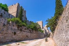Rhodos, Greece - August 2016: Walls of Rhodes old town and moat in the Palace of the Grand Master of the Knights of Rhodes. Kastello, a medieval castle in the royalty free stock photos
