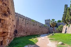 Rhodos, Greece - August 2016: Walls of Rhodes old town and moat in the Palace of the Grand Master of the Knights of Rhodes. Kastello, a medieval castle in the stock photography