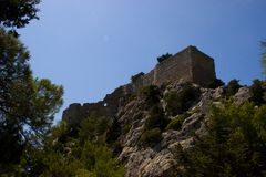 Rhodos Greece historic buildings architecture castle of Monolithos ruins. Castle of Monolithos Rhodos Greece blue sky sea travel europe ruins ancient royalty free stock photo
