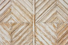 Rhomb pattern of the old weathered white painted wooden gate. royalty free stock images