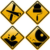 Rhombic yellow road signs with tools Stock Photo