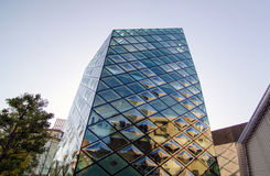 Rhomboid-grid glass building Stock Images