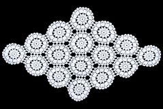 Rhomboid lace tablecloth isolated on black background, circle pattern. White rhomboid lace tablecloth isolated on black background, circle pattern. Cute out and royalty free stock photos