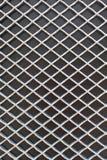 Rhombus metal pattern on black surface Royalty Free Stock Images