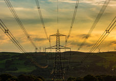 Rhondda Fach. Electricity pylon structures known as secondary transmission towers at sunset Royalty Free Stock Photo
