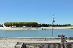 The Rhone in Arles, France. Quay of the Rhone in Arles, France Stock Photo