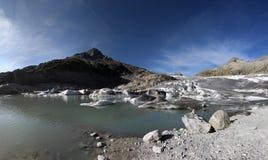 Rhoneglacier. Rhone Glacier calving in a lake stock photography