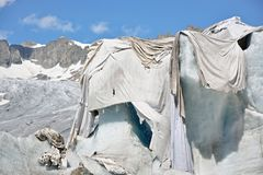 Glacier covered with sheets stock image