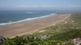 Rhossili beach and coast The Gower peninsula South Wales UK PAN stock footage