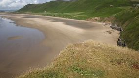 Rhossili beach The Gower peninsula South Wales UK PAN stock video footage