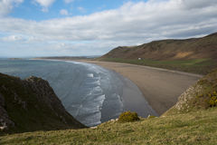 Rhossili beach, The Gower, South Wales. View along Rhossili Beach towards Burry Holms Royalty Free Stock Images