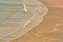 Rhossili beach in Wales. Nealr deserted wide sandy beach in Wales Stock Images