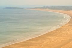Rhossili beach in Wales. Nearly deserted wide sandy beach bay in Wales Stock Photos