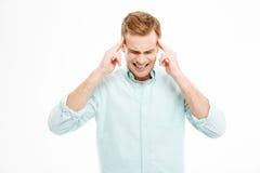 Rührende Tempel des stressigen deprimierten Mannes und haben Kopfschmerzen Lizenzfreie Stockbilder