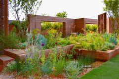 M & G show garden Chelsea Flower Show. The M & G Show Garden at the RHS Chelsea Flower Show in London May 2018. Designed by Sarah Price it shows hard landscaping stock images
