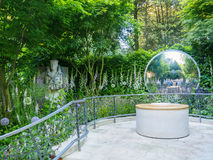 RHS Chelsea Flower Show 2017. The CWGC Centenary Garden. LONDON, UK - MAY 25, 2017: RHS Chelsea Flower Show 2017. The CWGC Centenary Garden. A reflective garden Stock Photography