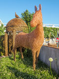 RHS Chelsea Flower Show 2017. Emma Stothard display with life-sized sculptures of animals and birds made of willow and bronze wire. LONDON, UK - MAY 25, 2017 Royalty Free Stock Image