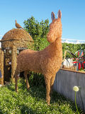 RHS Chelsea Flower Show 2017. Emma Stothard display with life-sized sculptures of animals and birds made of willow and bronze wire. LONDON, UK - MAY 25, 2017 Royalty Free Stock Photo
