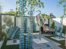 RHS Chelsea Flower Show 2017. Organic sculptural glass art for the garden display. LONDON, UK - MAY 25, 2017: RHS Chelsea Flower Show 2017. Organic sculptural Stock Images