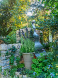 RHS Chelsea Flower Show 2017. The Poetry Lover`s Garden. LONDON, UK - MAY 25, 2017: RHS Chelsea Flower Show 2017. The Poetry Lover`s Garden. Formally structured Stock Photo